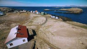 Flight along the coast of the island Vigur stock video footage