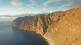 Flight along the huge rocks of Los Gigantes Tenerife stock footage