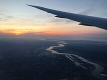 Flight Arriving In London During Sunrise During Fall. Royalty Free Stock Images