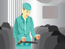 Flight attendant. Serving drinks in airplane Royalty Free Stock Images