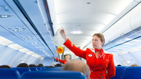 Flight attendant of Aeroflot at work. MOSCOW - MAY 28, 2011: Air hostess Yulia of Aeroflot shows how to use an oxygen mask on board. Aeroflot operates the Stock Image
