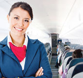 Flight attendant in an airplane Royalty Free Stock Photo