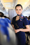 Flight attendant on airplane Royalty Free Stock Images