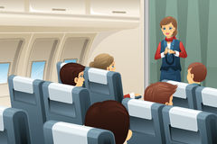 Flight attendant in an airplane. A vector illustration of flight attendant demonstrate how to fasten the seat belt to passengers Stock Image