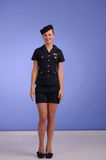 Flight attendant in black clothing Stock Photography