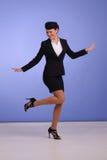 Flight attendant in black clothing Royalty Free Stock Photos