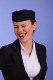Flight attendant in black clothing. Beautiful young flight attendant in black clothing Royalty Free Stock Photography