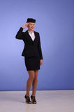 Flight attendant in black clothing. Beautiful young flight attendant in black clothing Stock Images