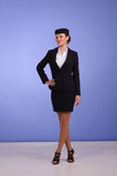 Flight attendant in black clothing Stock Images