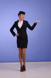 Flight attendant in black clothing. Beautiful young flight attendant in black clothing Stock Photography