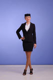 Flight attendant in black clothing. Beautiful young flight attendant in black clothing Stock Image