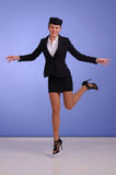 Flight attendant in black clothing. Beautiful young flight attendant in black clothing Royalty Free Stock Photos