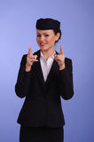 Flight attendant in black clothing. Beautiful young flight attendant in black clothing Royalty Free Stock Image
