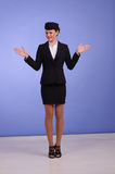 Flight attendant in black clothing. Beautiful young flight attendant in black clothing Royalty Free Stock Images
