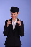 Flight attendant in black clothing. Beautiful young flight attendant in black clothing Stock Photo
