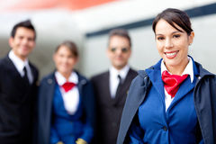 Flight attendant with cabin crew Stock Photography