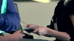 Flight attendant checking passports and boarding cards at airport terminal gate exit Stock Photos
