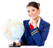 Flight attendant with the globe Stock Photo