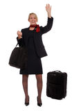 Flight attendant hailing a cab Royalty Free Stock Photo