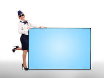 Flight attendant holding big panel Royalty Free Stock Photography