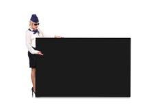 Flight attendant holding blackboard Stock Photos