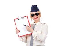 Flight attendant holding blank clipboard Stock Image