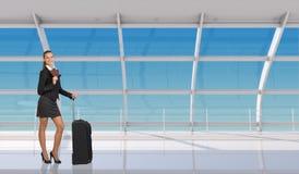 Flight attendant holding passport in airport Stock Image