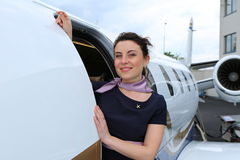 Flight attendant looking out the doors Royalty Free Stock Photo