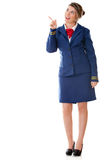 Flight attendant pointing Stock Image