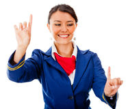 Flight attendant pointing destinations Royalty Free Stock Image