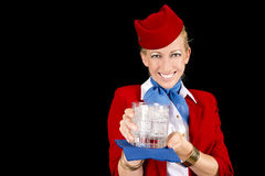 Flight Attendant Serving a Drink Royalty Free Stock Images