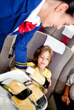 Flight attendant serving food Royalty Free Stock Photography