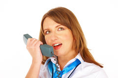 Flight attendant or stewardess talking on intercom Royalty Free Stock Photos
