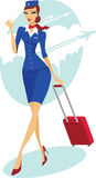 Flight attendant with suitcase Royalty Free Stock Image