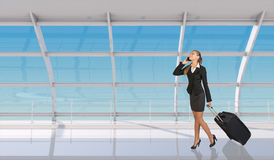 Flight attendant talking on mobile in airport Stock Images