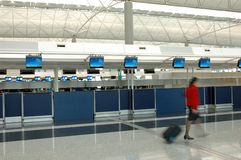 Flight attendant walking through the check-in counter Stock Image