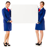 Flight attendants with a banner Stock Photo