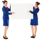 Flight attendants with a banner Royalty Free Stock Image