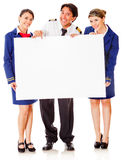 Flight attendants and pilot with banner Royalty Free Stock Photos