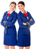 Flight attendants smiling Royalty Free Stock Image