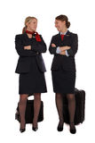Flight attendants talking together Stock Photo