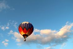 The flight of the ball in the clouds Stock Image