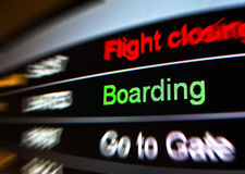 Flight Boarding. Closeup photograph of a boarding sign at an airport Stock Image