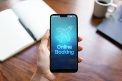 Flight booking application on mobile phone screen. Business and technology concept. royalty free stock image