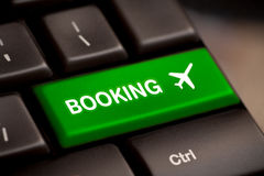 Flight booking keyboard plane travel fly check buy Royalty Free Stock Images