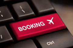 Flight booking keyboard plane travel fly check buy Royalty Free Stock Photo