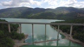 Flight on the bridge to the lake stock footage