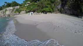 Flight of the camera above the beach stock footage