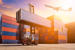 Flight cargo flying over Logistic cargo container. In shipping yard. Photo concept for Global business shipping,Logistic,Import and Export industries Royalty Free Stock Images