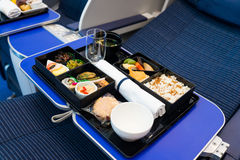 In-flight catering. On the plane Royalty Free Stock Photos